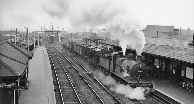 Bromsgrove 1960, with Up freight rushing the Lickey Incline