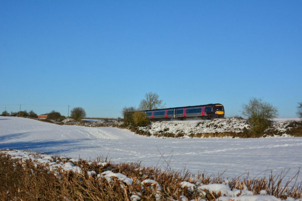 Train 170101 Abbotswood Jn snowscene 1M64-1145-Cardiff-Central-to-Nottingham-111217-S-Widdowson.jpg
