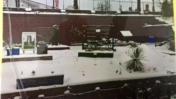 Evesham Station garden with winter snow